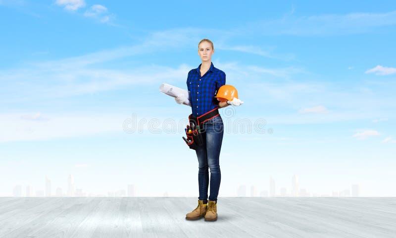 Constructor de la mujer foto de archivo