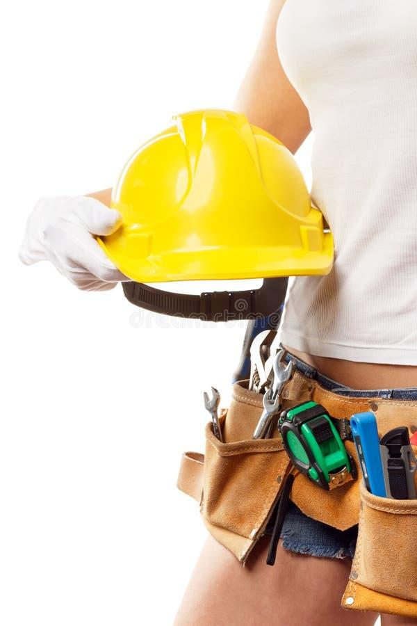 Constructor de la mujer con el sistema de herramientas de la construcción, aislado imagen de archivo libre de regalías