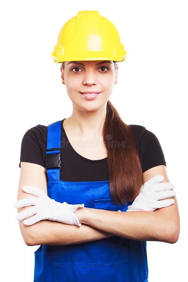 Constructor de la mujer en el uniforme azul imagen de archivo libre de regalías