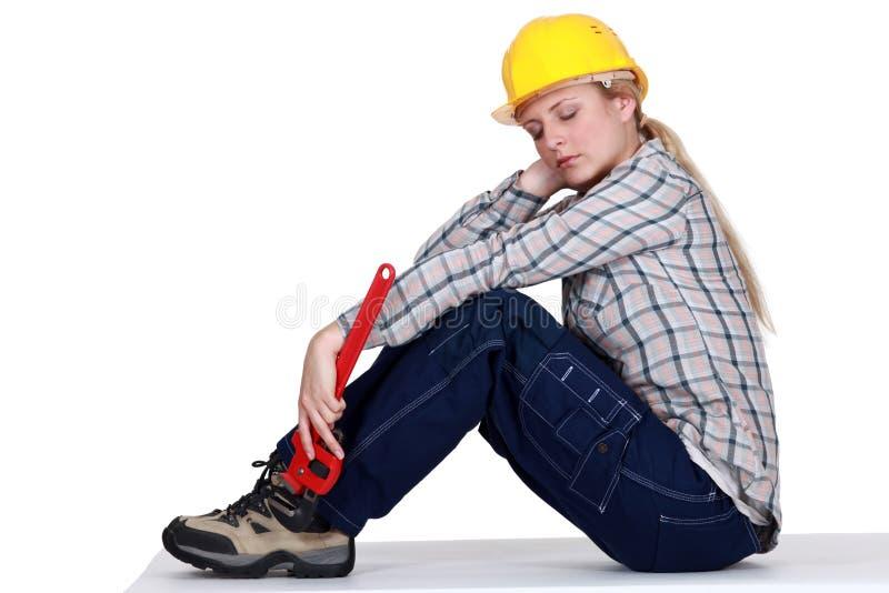 Constructor de sexo femenino cansado fotografía de archivo