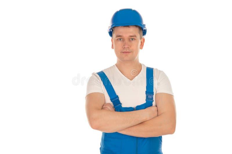 Constructor de sexo masculino joven con las manos cruzadas fotos de archivo libres de regalías