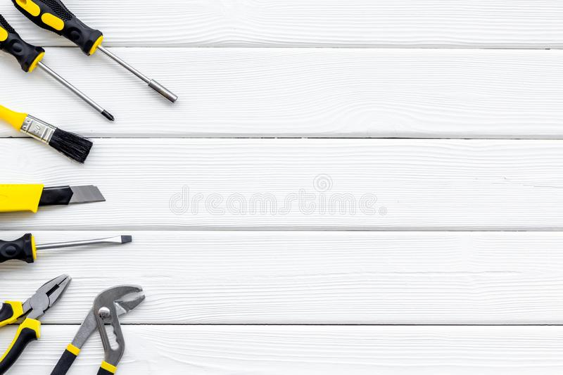 Constructor desk with set of building implements and brushes white wooden background top view mock up. Constructor desk with set of building implements and stock photos