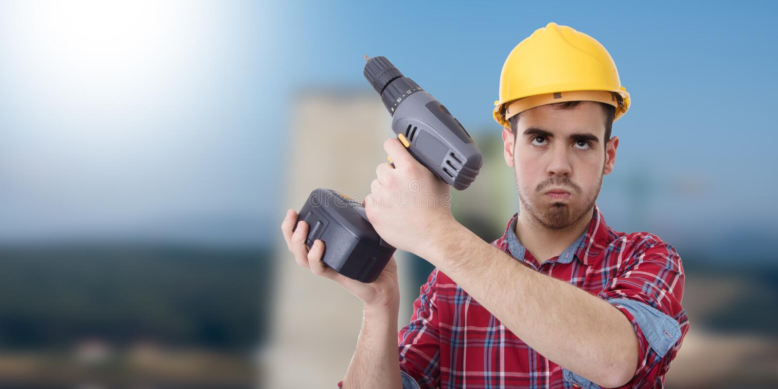 Constructor with drill. Renovations, repairs and bricolage royalty free stock photo