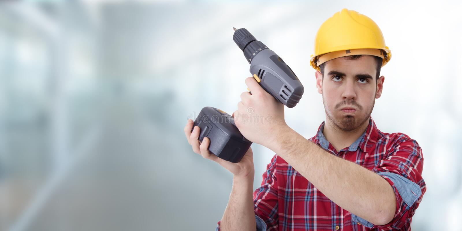 Constructor with drill. Renovations, repairs and bricolage stock photography
