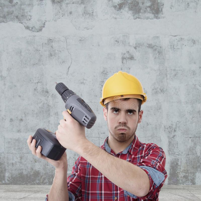 Constructor with drill. Renovations, repairs and bricolage royalty free stock photos