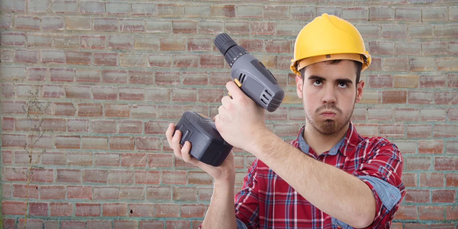 Constructor with drill. Renovations, repairs and bricolage stock images