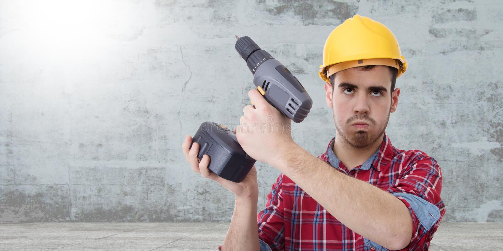 Constructor with drill. Renovations, repairs and bricolage royalty free stock image