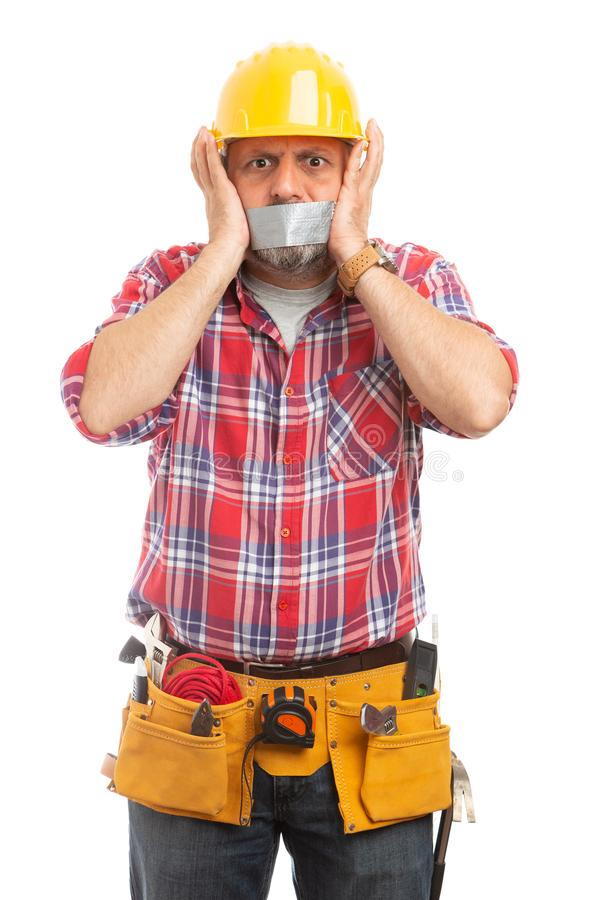 Constructor with duct tape on mouth royalty free stock photo