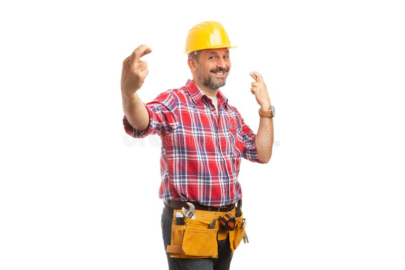 Constructor with fingers crossed as good luck concept royalty free stock photography