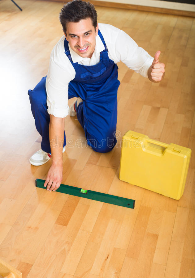 Constructor fixing laminate flooring royalty free stock images
