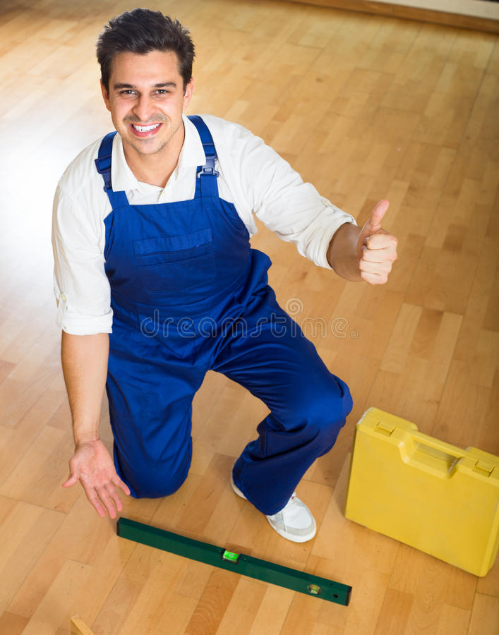 Constructor fixing laminate flooring stock photos