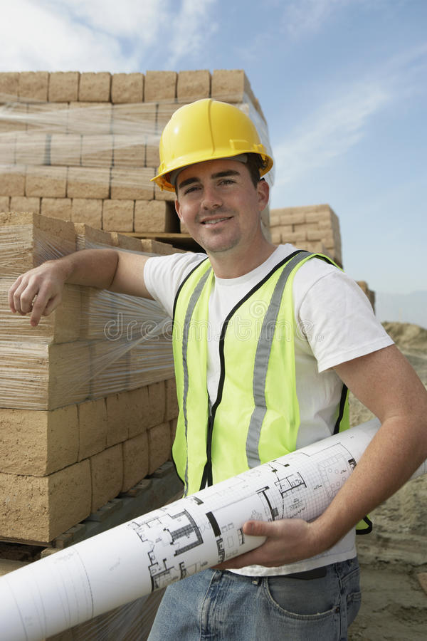 Download Constructor Holding A Blueprint Stock Photo - Image: 29652514