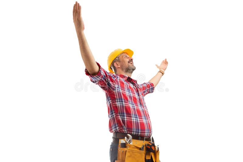 Constructor holding hands up as success sign royalty free stock photo