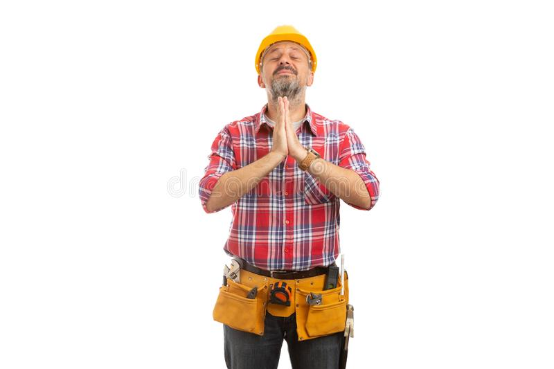 Constructor with joined hands stock images
