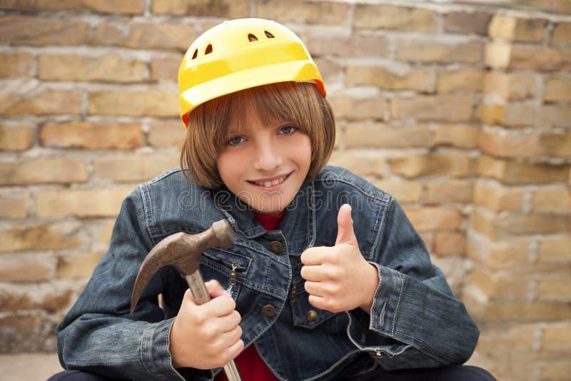 Constructor joven imagenes de archivo