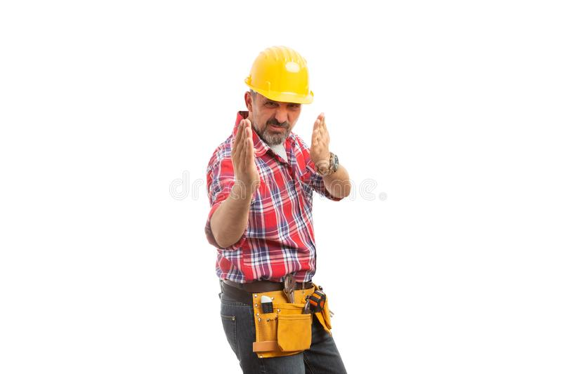 Constructor making karate move royalty free stock image