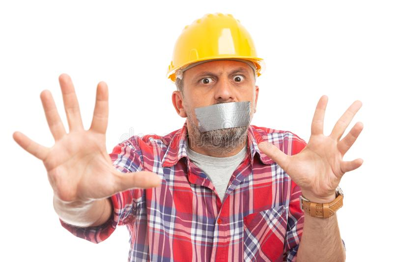 Constructor making stay away gesture with hands royalty free stock photography
