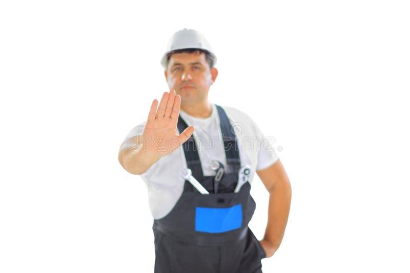 Constructor que hace la muestra de la parada foto de archivo libre de regalías