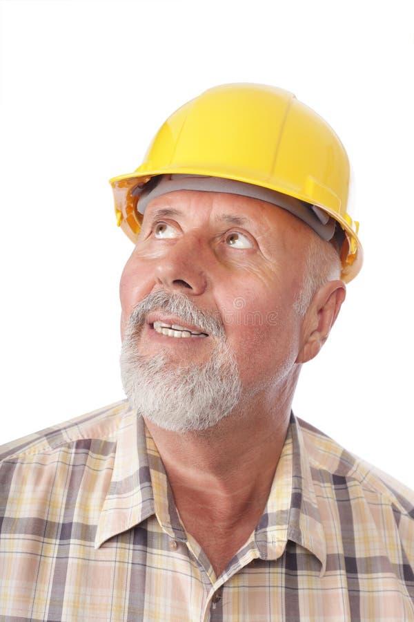 Constructor que mira lejos imágenes de archivo libres de regalías