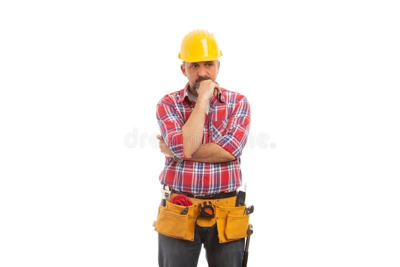 Constructor que toca la barbilla como planeamiento fotos de archivo