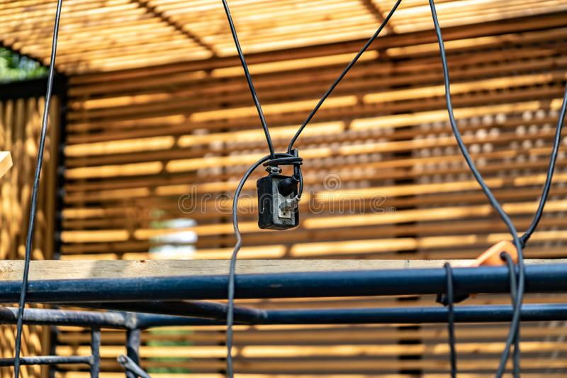 The constructor sets the power plug and electric cable connects together by hanging top of the floor to avoid from walking away. The constructor sets the power royalty free stock images