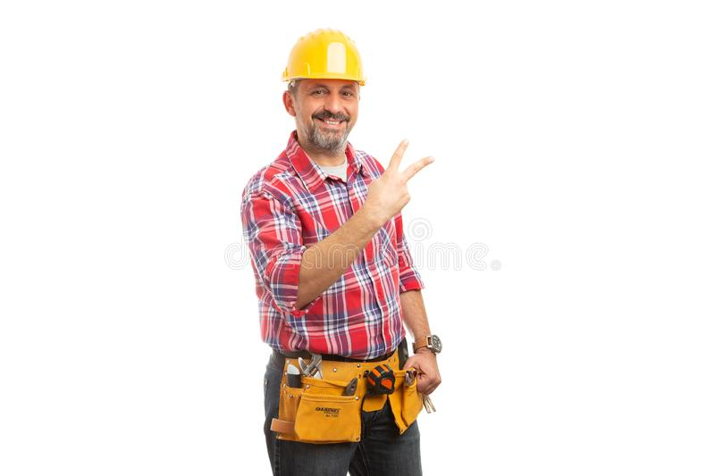 Constructor showing two sign with fingers stock images