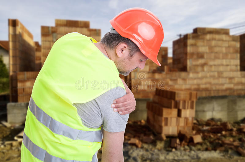 Constructor suffering from shoulder pain stock images