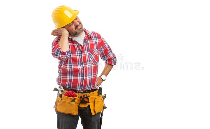 Constructor touching stuffed ear stock photography