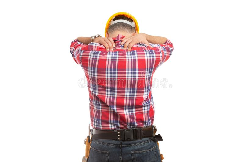 Constructor touching upper back royalty free stock photos