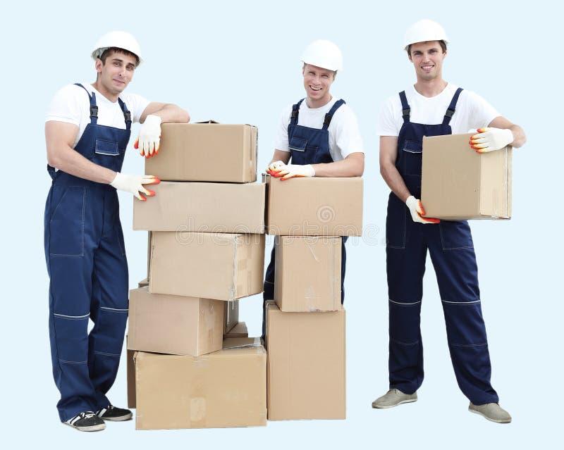 Constructores del grupo de personas con las cajas imagenes de archivo