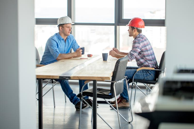 Constructors are having breakfast at workplace royalty free stock image