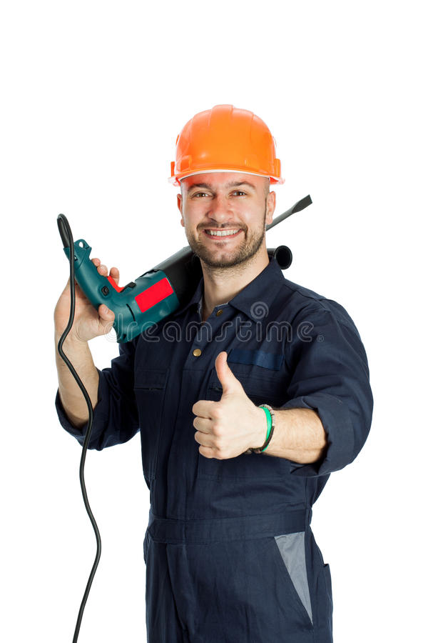Construtor com a broca isolada no fundo branco fotos de stock
