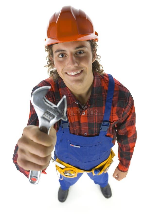 Construtor com chave ajustável fotografia de stock