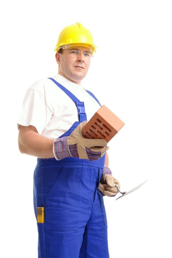 Construtor com tijolo e trowel imagem de stock royalty free