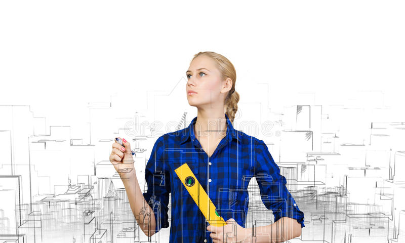 Construtor da mulher imagens de stock