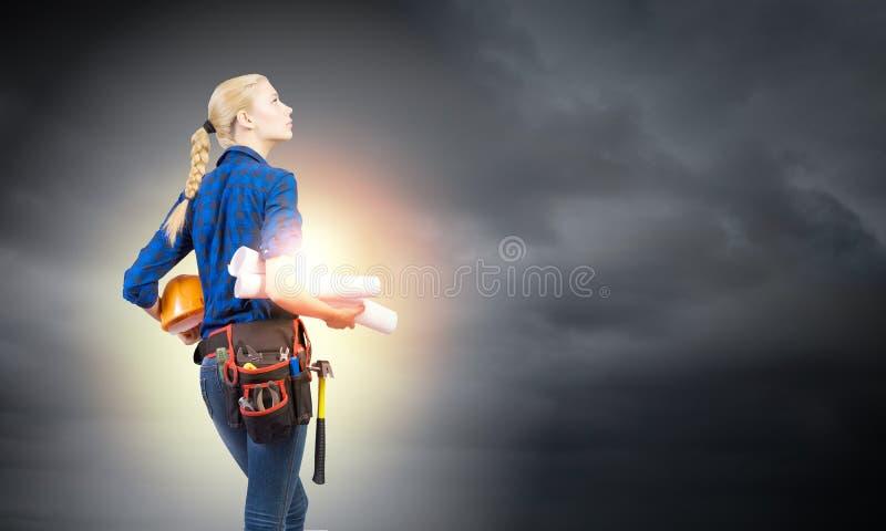 Construtor da mulher fotografia de stock