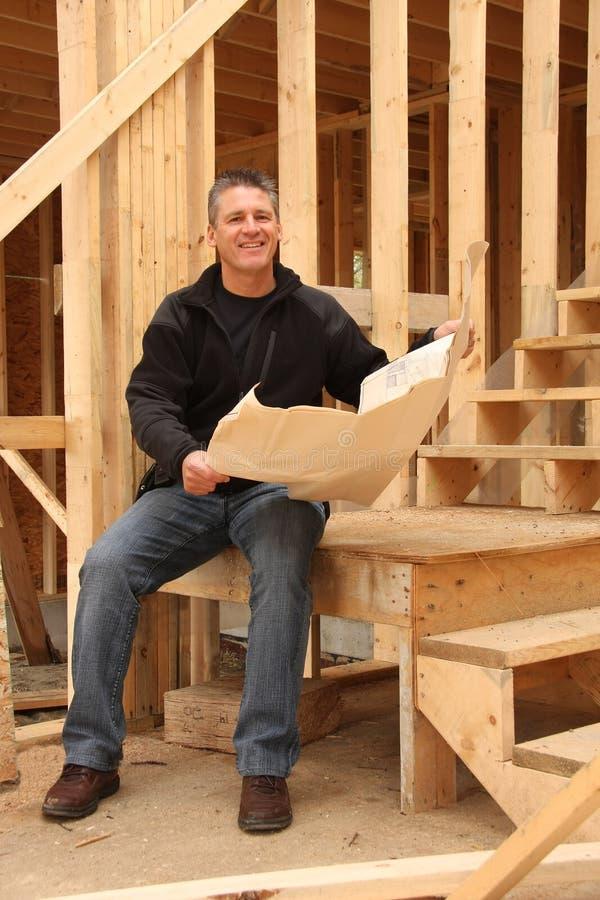 Construtor de casa imagens de stock royalty free