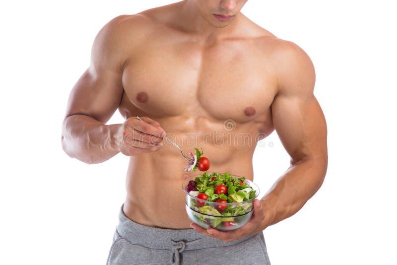 Construtor de corpo comendo saudável do halterofilista do halterofilismo da salada do alimento foto de stock royalty free