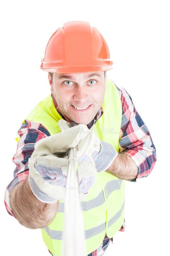 Construtor masculino de sorriso que toma um autorretrato fotos de stock royalty free