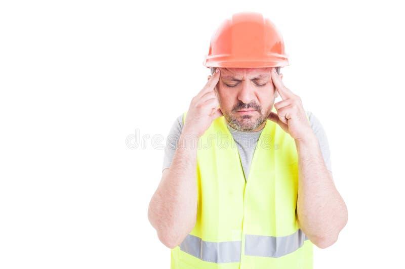 Construtor novo forçado que tem a dor de cabeça ou a enxaqueca fotos de stock royalty free
