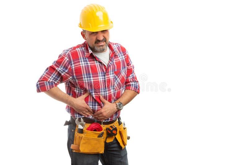 Construtor que toca no abdômen como problemas do fígado fotos de stock