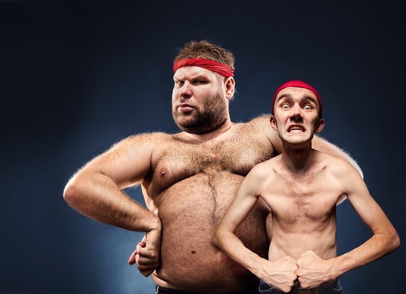 Construtores de corpo engraçados fotos de stock royalty free