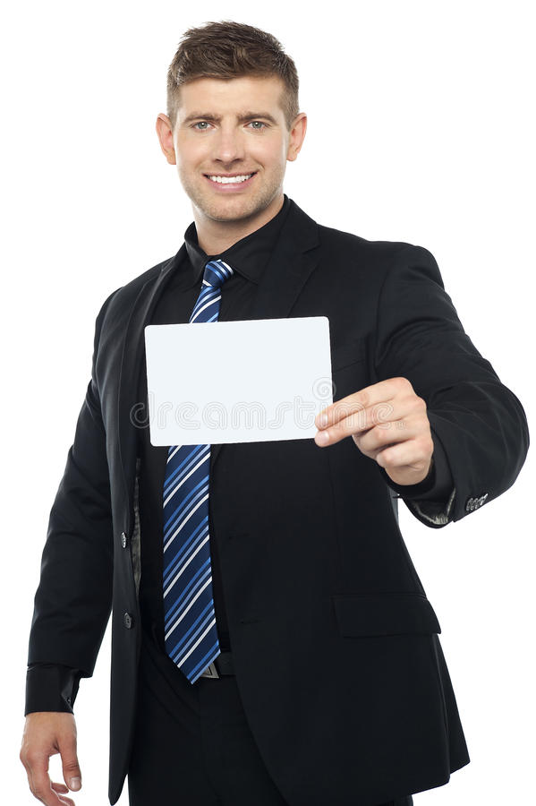 Consulente in materia di affari che presenta cartello in bianco fotografie stock libere da diritti