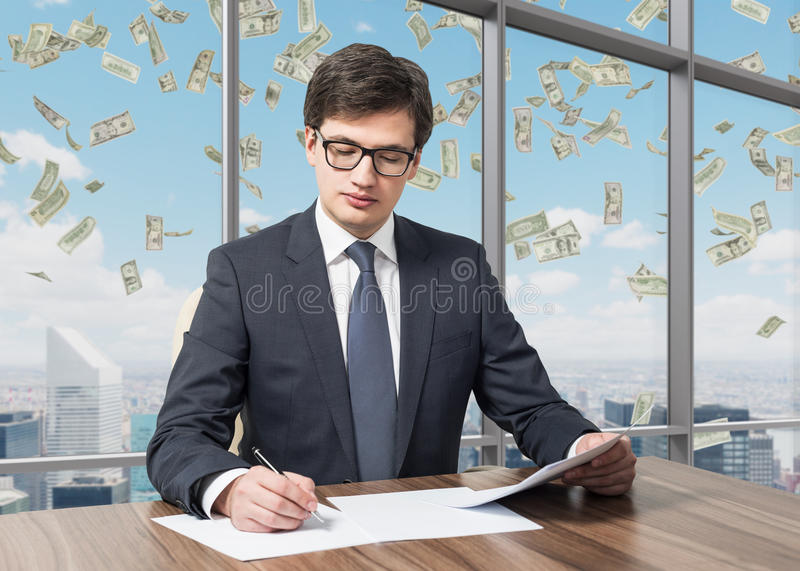 Consultant is dealing with due diligence process in a modern skyscraper office with a panoramic New York view. Mone. Handsome legal consultant is dealing with royalty free stock photos