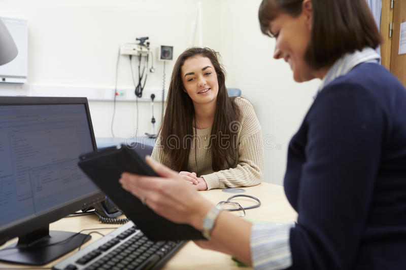 Consultant Discussing Test Results With Patient royalty free stock photo