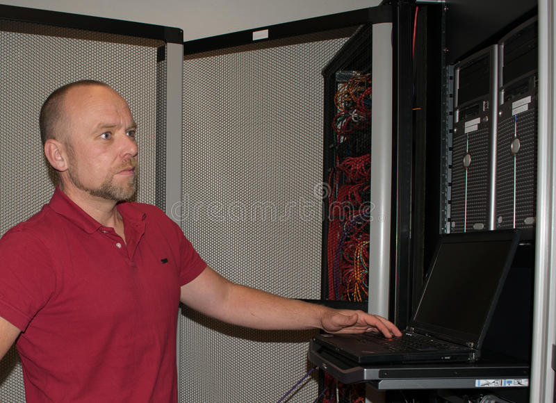 IT consultant performs work in a data center stock images