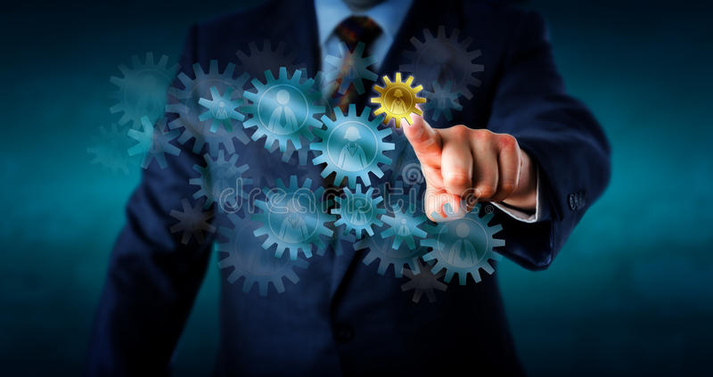 Consultant Selecting Small Female Worker Cogwheel royalty free stock photo