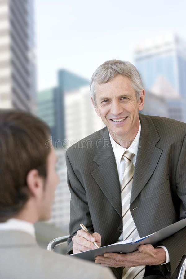 Consultant Taking Notes Stock Photography