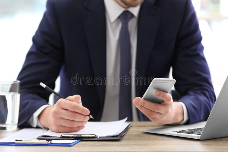 Consultant working at table stock images