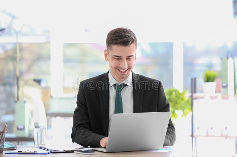 Consultant working at table stock photos